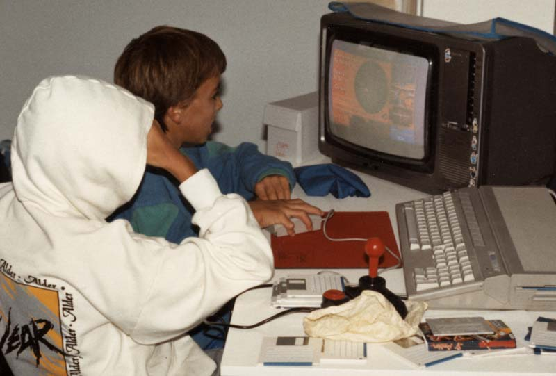 Image showing Paulie and his brother playing the Atari ST